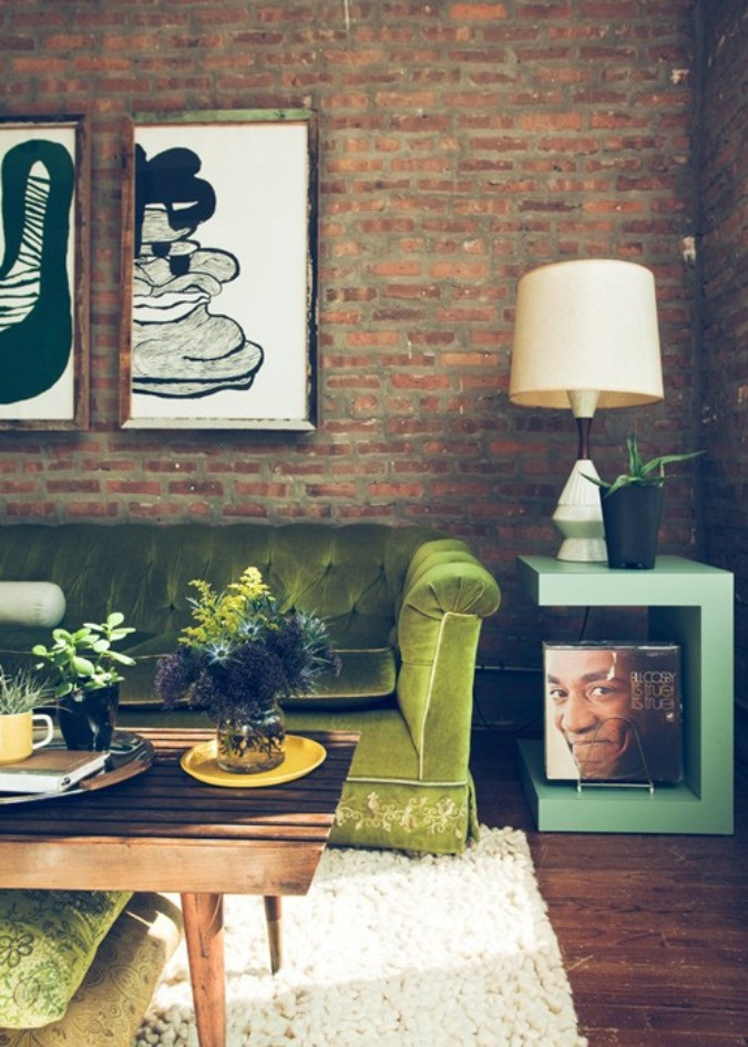 brick wall green couch
