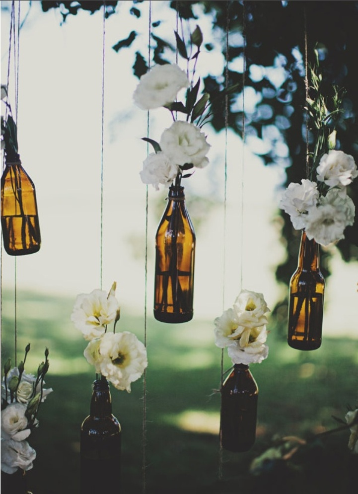 floral wedding decor with bottles