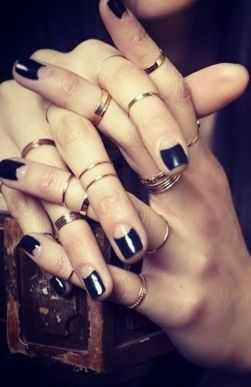 nude and black reverse french mani