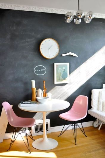 pink eames chairs and black wall