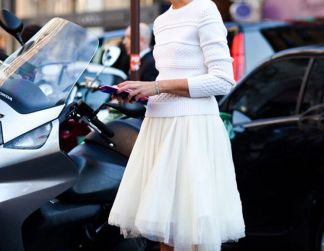 white sweater over skirt